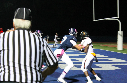 Ryan Fitton 17 defends a Stamford player in the endzone.