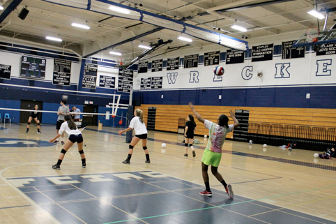 Shannon Cardoza '15, a defensive specialist, serves the ball as her team practices in order to try and improve their third place standing in the FCIAC Central.