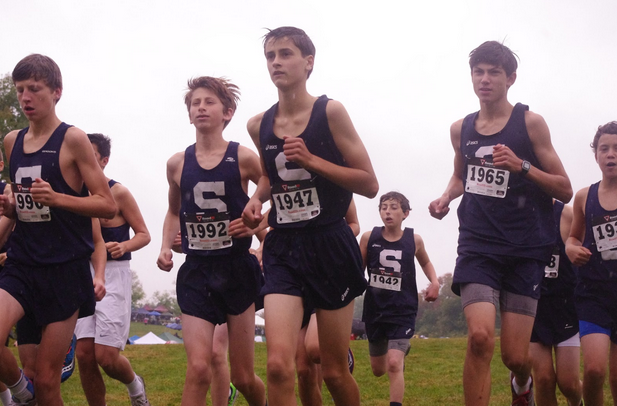 Freshman boys' XC warm up and do striders to prepare for their race at Wickham Park Invitational, the boys placed fourth in the Freshman race.