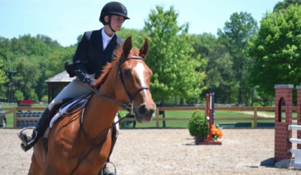Megan Hagarty, who attends a private school in Stamford, rides in a competition at the Hunt Club on June 1, 2014