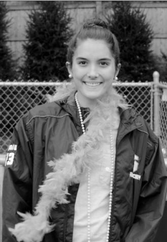 Aishah Avdiu '17, a member of the girls' varsity field hocker team, sports her senior day gear.