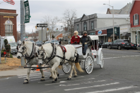 The Westport Downtown Merchants Association, sponsors of the event, cart Westport citizens in an old fashioned horse and buggy on Dec. 13 and 14.