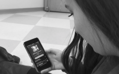 """Tuning In -- Melanie Orent '16 browses through Spotify's Afternoon Acoustic playlist and listens to Jasmine Thompson's acoustic version of """"Thinking Out Loud,"""" originally sung by Ed Sheeran."""