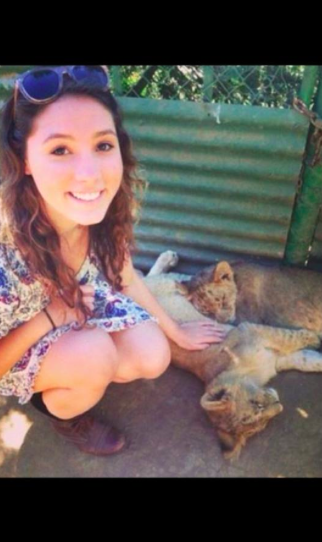 Photo contributed by Sophie de Brujin '14: Sophie de Brujn takes a break from her hard work and visits some lions in the town of Vrede in the Free State province of South Africa.