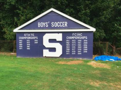 Staples soccer bonds through building