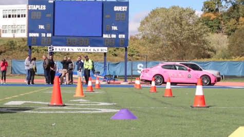 Students try out distracted driving simulation