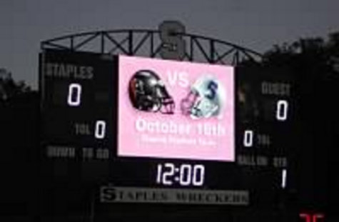 Staples students help fight breast cancer at Pink Day Game