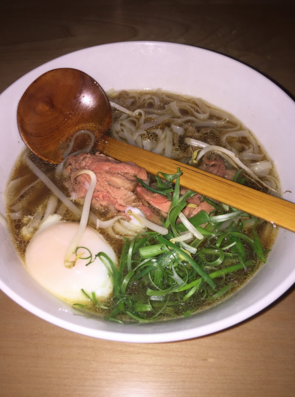 The Smoked Rare Brisket Pho featured in the noodles section of the menu.