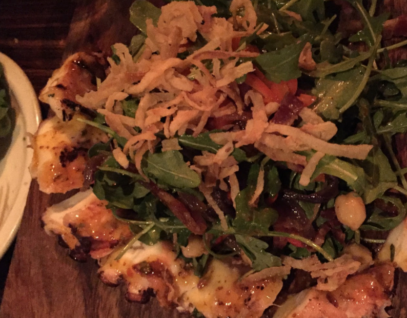 Shown above is a spicy arugula salad surrounded by a charred octopus, which is just one of the many tasty specials Bodega offers.