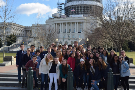 The Staples Chapter of JSA poses in front of the Capitol Building when sightseeing on Friday, Feb. 26