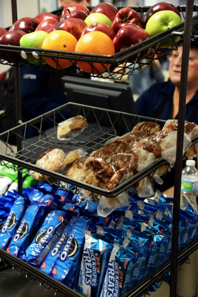 "Rice Krispies and Cookies line checkout aisles in ""the Caf"""