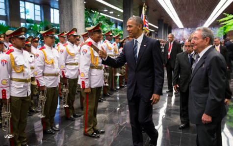 President Obama with President Castro is welcomed by Cuban honor guards.