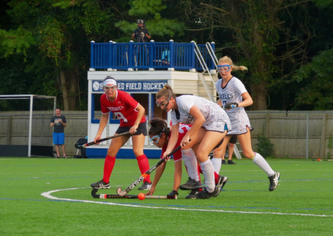 Captain Colleen Bannon '17 re-defends the ball after causing a Greenwich attacker to turn it over.