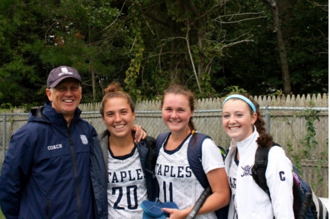 Staples coach, Ian Tapsall and captains (left to right) Christine Taylor '18, Colleen Bannon '17 and Chloe Deveny '17 sport smiles after their tie with the defending state champions, the Wilton Warriors.