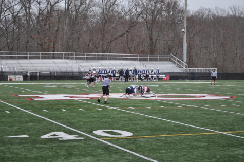 Staples fights for possession against New Canaan to begin the game