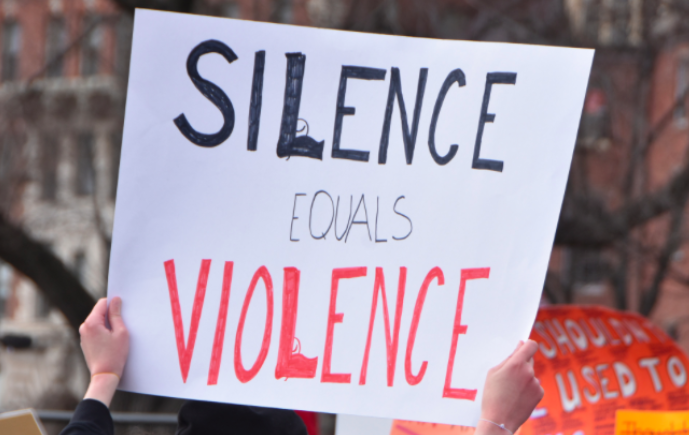 Faculty and students wear orange to protest gun violence