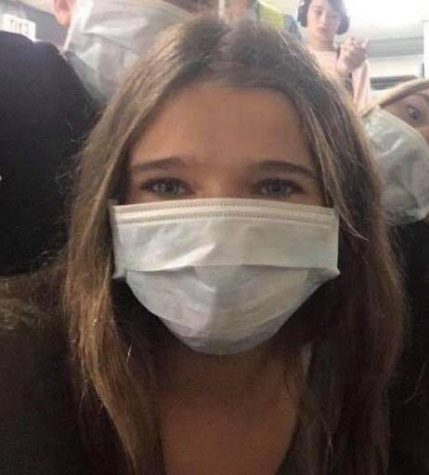Raquel Cross '23 wears a face mask to Coleytown Middle School (CMS) on Sept. 18 due to air quality concerns. CMS eighth grade students began classes at Staples High School this week after CMS closed down amid ongoing mold growth.