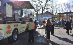 People enjoy food from the food trucks at the local Westport Farmers Market.