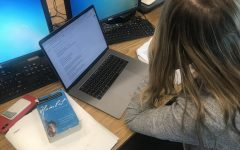 """A Staples High School senior works to complete hours of homework. Stanford University researchers identified between 90 and 150 minutes as the """"optimal"""" amount of homework in 2014."""