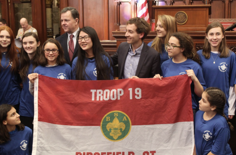 State senator, Will Haskell, poses with part of Troop 19, that consists of girls officially joining Scouts of America. The new rule that went into effect Feb. 1, now allows girls between 11 and 17 to join what was formerly known as Boy Scouts of America.