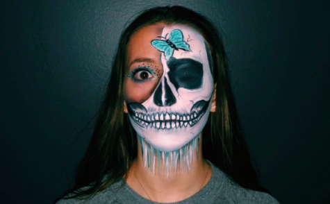 Emmy Marcus '22 poses for a picture on her instagram displaying her detailed artwork that she created on her face.
