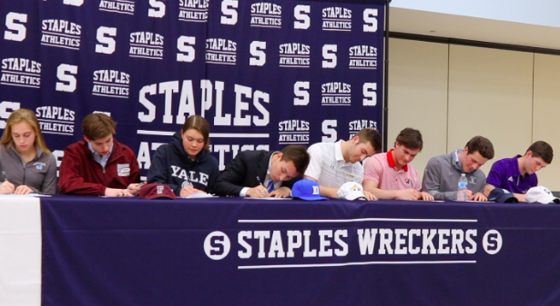 Ten+Staples+seniors+sign+their+letters+of+intent%2C+officially+committing+to+Division+I+universities+to+continue+their+academic+and+athletic+careers.