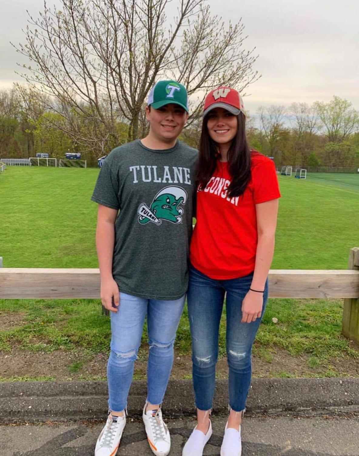 Hannah Bolandian '19 and Nicky Brown '19 pose for a picture before school on decision day. Both are decked out in the college they are attending.