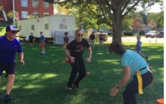 Westport police officers smile while participating in Capture-A-Cop, a capture the flag game between Westport middle school students and local law enforcement on Sunday, Sept. 15.