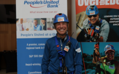 Ed Finnigan prepares to remove his harness after rappelling the People's United Bank in Bridgeport, Connecticut.