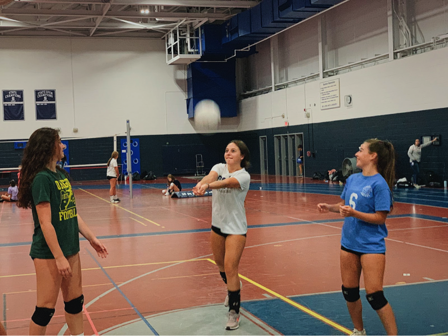 Staples+sophomores+%28from+left%29+Layla+Bloomingdale%2C+Karina+Murray+and+Chloe+Murray+warm-up+for+their+volleyball+practice+that+is+over+two+hours+every+day.+After+their+workout%2C+they+must+go+home+to+do+hours+of+homework.%0A