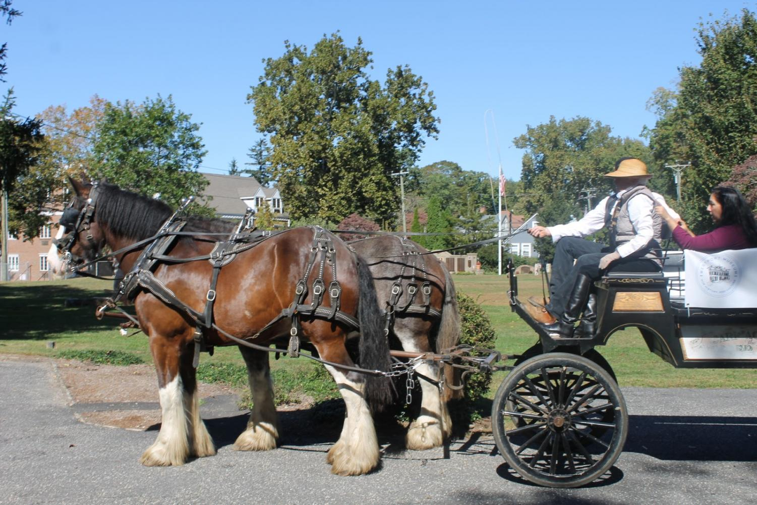 A horse carriage arrives at the Westport Historical Society for the Family Creep Fest, which offers families hayrides throughout downtown. Photo by Anastasia Thumser '22.