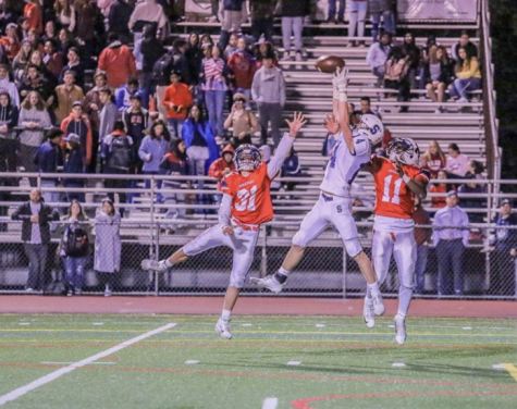 Ryan Thompson '22 makes a miraculous grab over two defenders in the third quarter bringing Staples to the McMahon one yard-line.