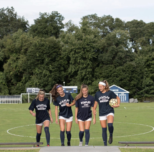 This year, Staples girls' soccer captains foster chemistry, hard work and success.