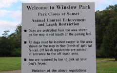 An Informational sign stationed at the entrance of Winslow Park explains the rules and policies for leash restrictions. Local dog walkers reported spotting many dogs walking off leash in the park.