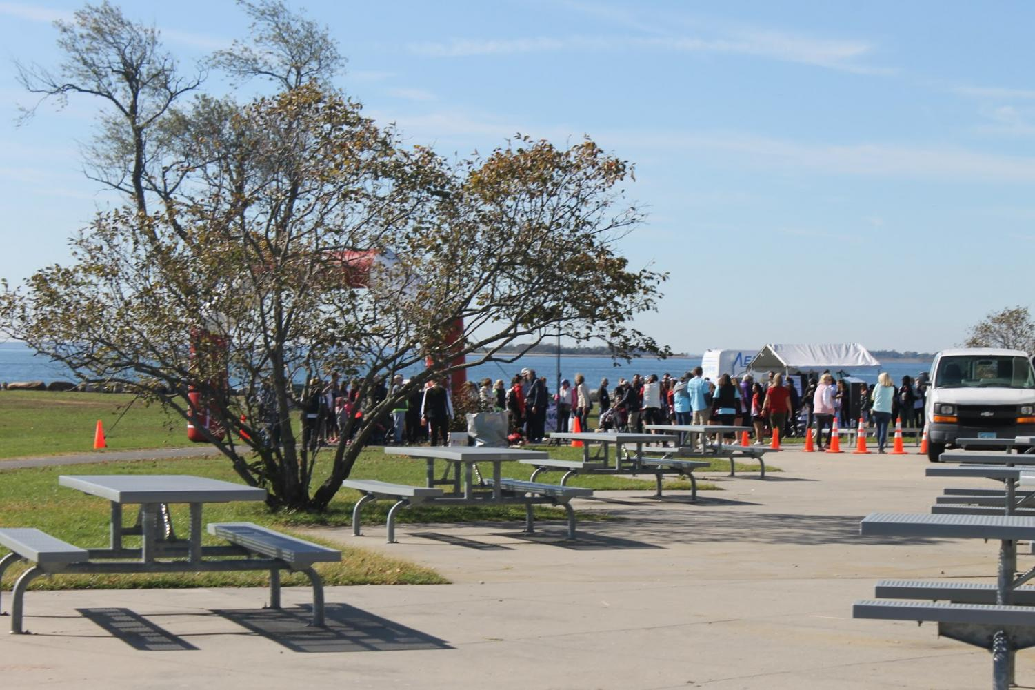 Local residents walk to the start of the Walk to Defeat ALS on Saturday, Oct. 19.