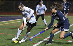 Staples field hockey shares FCIAC championship victory with Darien