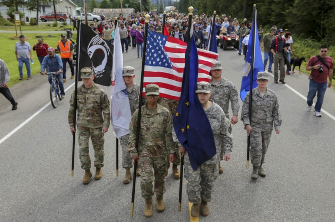 Members of the Alaska Air and Army National Guard and Alaska State Defense Force march in Klawock, Alaska.