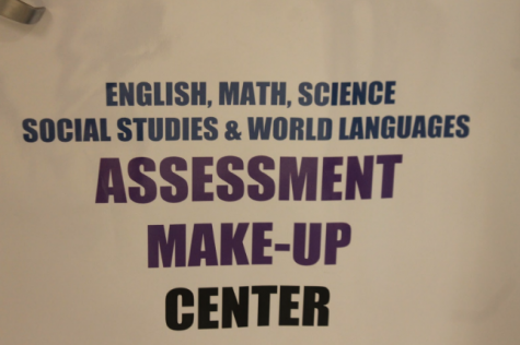 Photo of sign outside of the Assessment Center. It is located on the door of the make-up center.