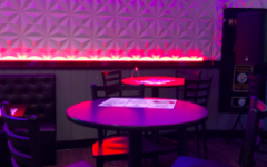 Small bar tables are set up all around Fusion Cafe and Bar to invite adults to eat and drink. The set up is meant more for adults than it is for kids.