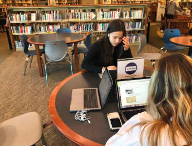 As the week comes to an end, Maddie Hill '22 and Ally Benjamin '22 study for their upcoming exams