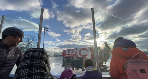 People watch as the zamboni at Longshore Ice Rink resurfaces the ice, preparing for a packed rink on Sunday afternoon.