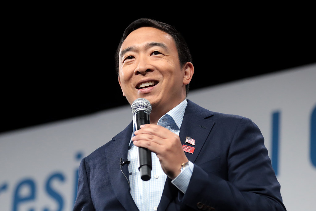 Andrew Yang addresses a crowd of supporters at a gun violence event in Des Moines, Iowa. He supports creating an effective nationwide gun licensing program, banning assault weapons and supporting the mentally ill to prevent gun violence.