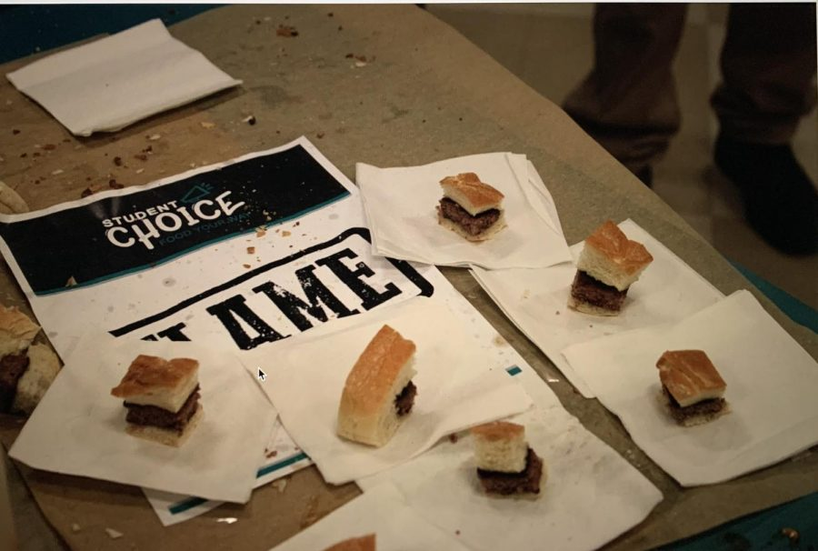 Students were able to vote towards chicken sliders or hamburgers through taste testing outside the Cafeteria.