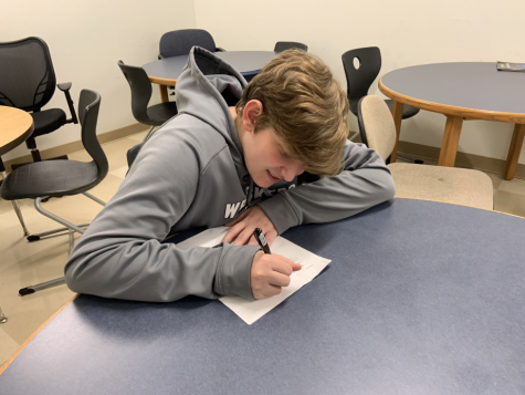 Jake Ment '22 imitates taking the PSAT which took place on March 4 and 5. Upperclassmen got to come in late both days so freshmen and sophomores could take the test.