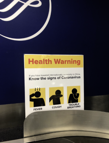 This sign at LaGuardia Airport warns of the coronavirus weeks before schools close.