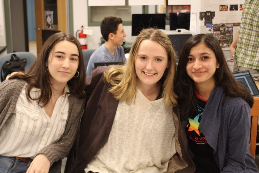 Yearbook committee members and editors Leah Chapman '22, Zoë Kaye '22 and Srushti Karve '23 all work in the library classrooms to deliver yearbooks