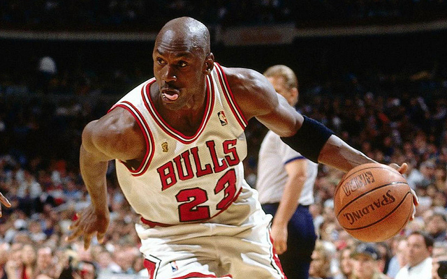 Michael Jordan drives to the hoop with determination