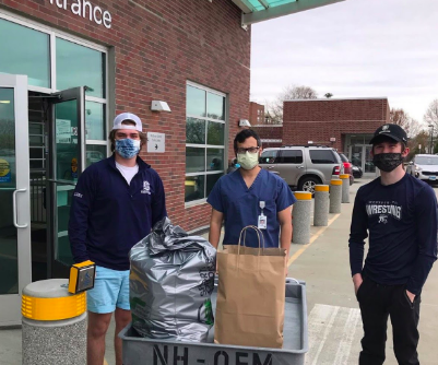 Staples wrestling team captains Nick Augari '22 and Gerard Dallen '22 deliver Feed It Forward donations to Norwalk Hospital.