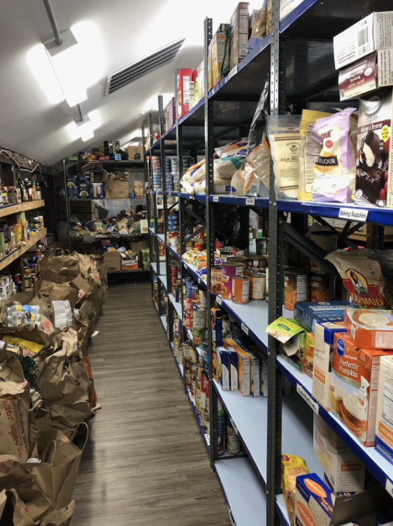 The food pantry at the Gillespie Center is well-stocked after a recent food drive, allowing them to provide for those affected by the pandemic.