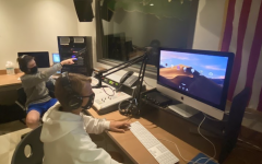 Evan Trock '22 (left) and Nick Sikorsky '24 (right) prepare for a WWPT radio session. Students who are online can be broadcasted into this room using Zoom and can participate as usual.